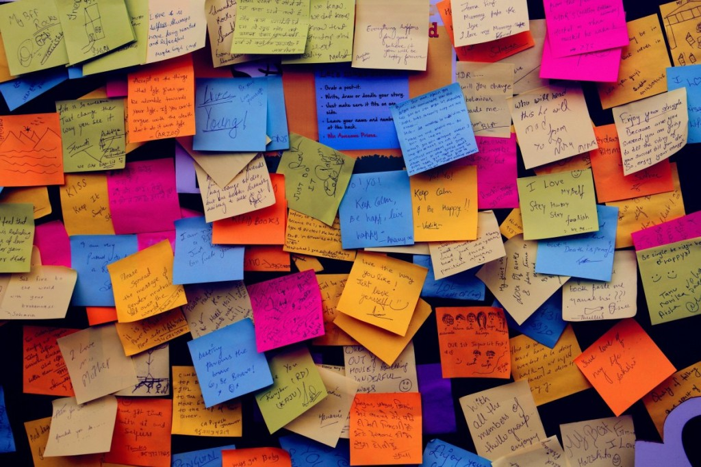 wall of coloured post it notes