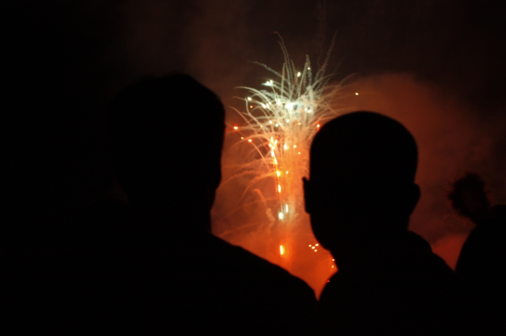 two silhouettes watching fireworks
